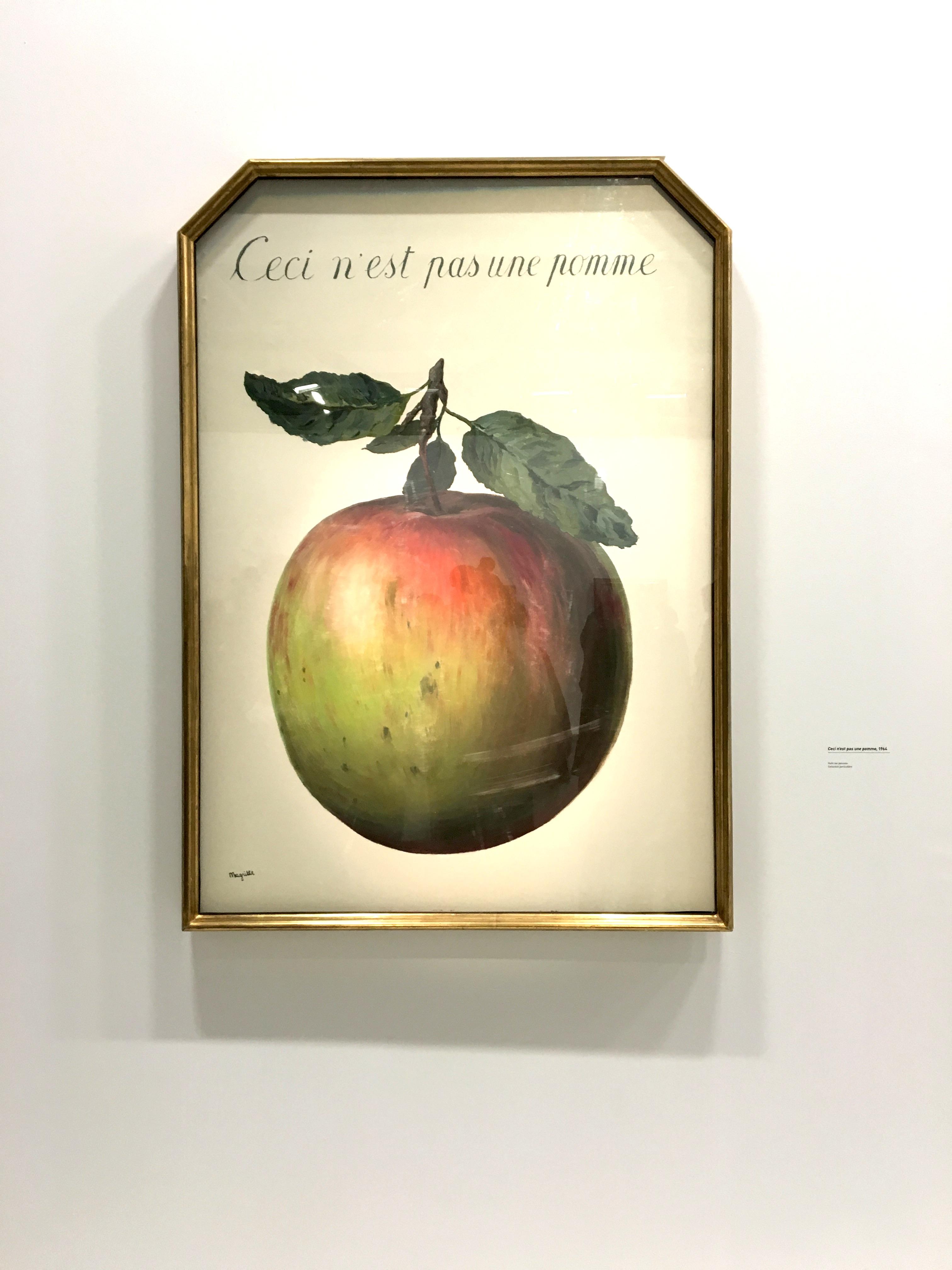 Peinture de magritte Ceci n'est pas une pomme